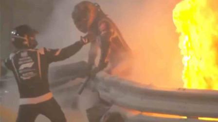 F1巴林站比赛中一赛车撞墙起火 车手28秒大火中极速逃生