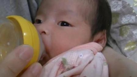 月子里的小宝宝喝奶超享受,喝到最后饱嗝都出来了,那模样太萌了
