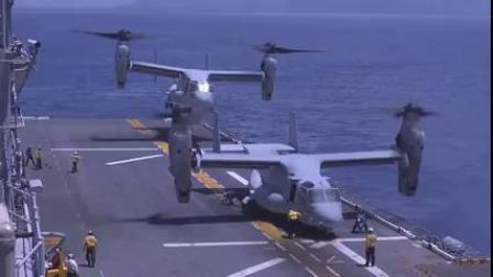 美国黄蜂级两栖攻击舰舰上的MV-22B倾转旋翼机和F-35B垂直起降战斗机飞行任务
