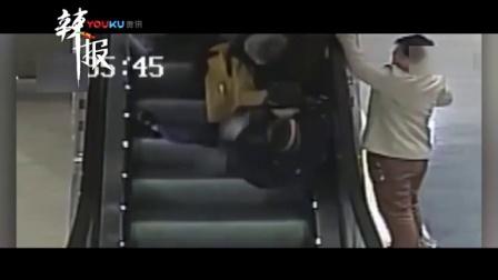 """老人乘电梯摔倒 她用身体当""""肉垫""""保护"""