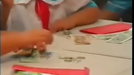 人教版小学数学第二册认识人民币课堂实录