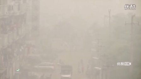 【拍客】武汉雾霾恍如末日 市民戴口罩出行