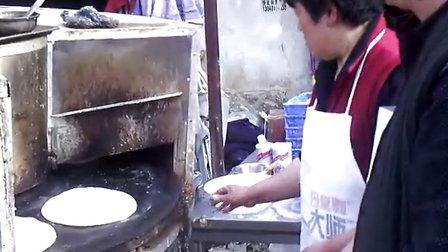张口笑万能烧饼机万能烤饼炉制作的转炉芝麻香大烧饼