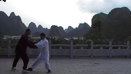 Henry push hands with his student in school