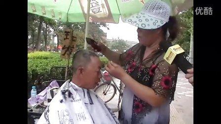 河北廊坊市街头快乐的剃头匠