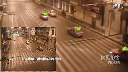 武汉交警拼死执法被拖行2公里 三勇的哥奋勇相救www.njapple.com.cn