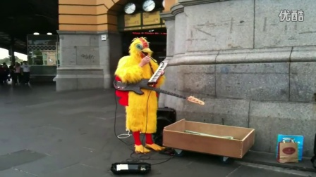 Man in a Chicken suit plays -What is Love- on Pianica