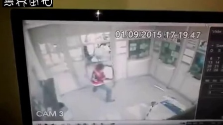 大锤砸银行被同伙误射脸部