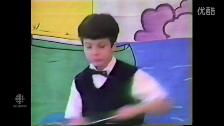 a-young-yannick-nezet-seguin-conducts-in-a-school-performance