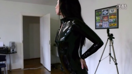 Vera in Wrapa's House in latex catsuit