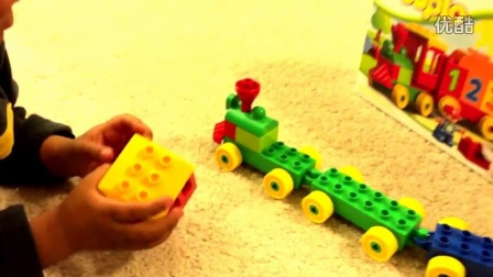 Kid playing with toys Lego Duplo Number Train To