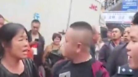 女子误以为警察把丈夫打伤 怒扇警察
