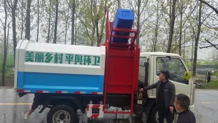 凯马5方蓝牌自装卸(挂桶)垃圾车操作视频