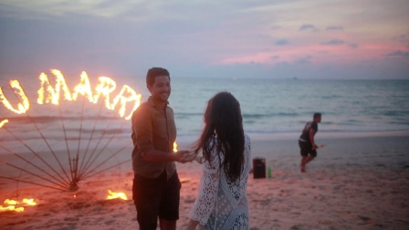 Sunset marriage proposal with fire dance performance
