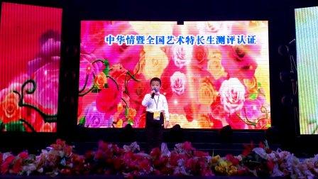 牡丹江少年领袖口才学校学员孙朝岳参加中泰国际文化交流赛进行口才表演