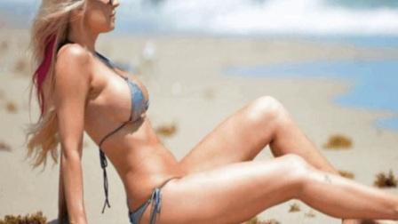 欧美女星艾莎海滩度假,网友30岁膝盖就是这么红的