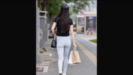 街拍女神:紧身牛仔裤美女,这么瘦还能这么丰盈,要赞