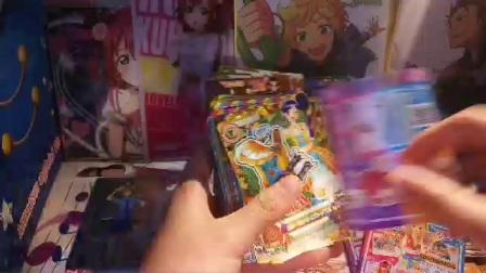 lovelive偶像活动出卡出周边,只是出了很少一点嗝,大概四月底去日本估计比这次买的卡还要多,可能带1w的吧,害怕桌子放不下所以来出卡