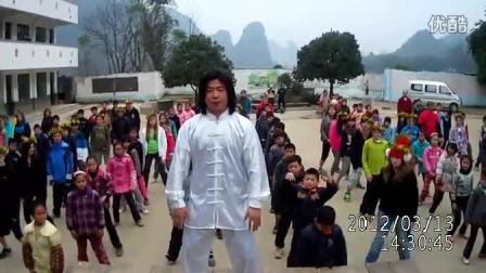 Master Huang teaches tai chi for school kids