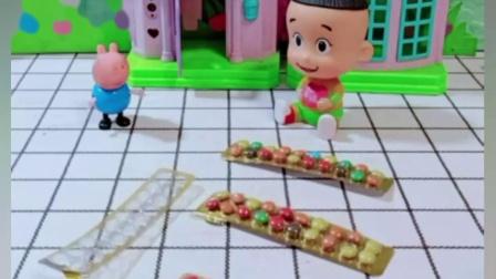 乔治贪吃把巧克力豆都吃了,只能重新给妈妈做一份,做的是苹果味的!