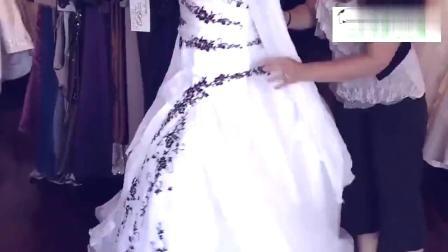 超漂亮的欧式白色婚纱,黑色的花纹点缀彰显大气,让你做最美新娘