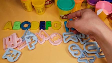 玩用饼干模具制作的字母学习字母表和学龄前儿童的单词