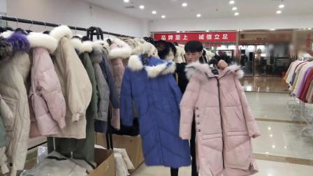 杭州品牌羽绒服 100%长款大毛领羽绒服杭州诚安奇服品牌女装折扣批发厂家一手货源