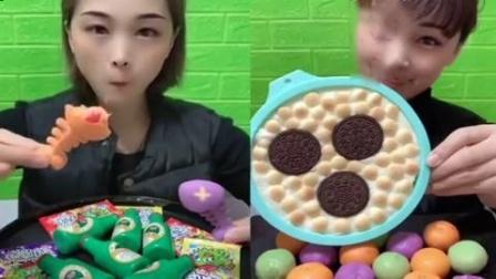 小姐姐试吃:巧克力夹心小鱼、奥利奥饼干,甜甜的超美味,很好吃的样子