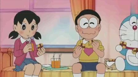 哆啦A梦静香给大雄烤饼干吃,大雄心开怒放了,周围温度升高.