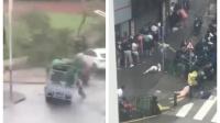 货车被台风吹翻瞬间 司机用手支撑被砸