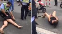 女子追打交警被制服 脱内裤放罚款