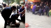 两城管当街暴打女摊贩 群众称没人性