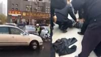 疯狂!男子撞人逃逸 交警追捕被撞伤