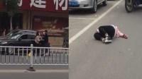 一男一女当街互殴 女子躺地不起被送医