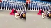 女子骑车摔倒 头卡护栏抽搐不止