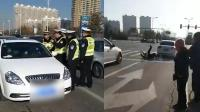 忻州轿车司机拒查撞伤交警:曾在交警队工作过