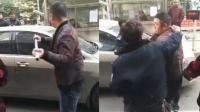 停车费引纠纷 物业当民警面狂砸车