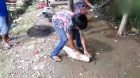 越南小屁孩钓鱼, 分分钟就钓上一条大鲶鱼, 不服不行啊!