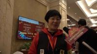 采访艺凡年会签到组志愿者戴秀玲老师