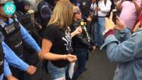 洪都拉斯反对派支持者抗议总统连任 女子在警察面前热舞