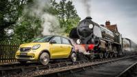 这辆汽车可以在铁轨上跑, 能拉动100吨的火车车厢!