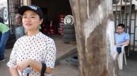 68集: 中国人在二手轮胎店补胎, 请当地黑人吃棒棒糖