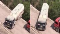 罐车司机悬崖处掉头 车身近一半悬空