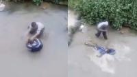 实拍男童疑似偷钱 遭男子拖入水坑暴踹猛打