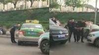 男子当街持棍砸车威胁的哥 特警果断制伏