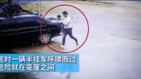 货车逼近的瞬间, 男子停车抱走穿马路的女童