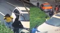 女子街头被撞一怒砸车 惨遭司机撞进绿化带
