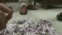"""ATM机遭老鼠""""袭击"""" 120万卢比钞票被撕成碎片"""