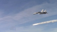 实弹打靶、夜间起降 ! 央视罕见曝光大量航母舰载机歼-15画面