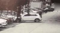 惊险! 女司机错踩油门 将车辆撞下三米高坎